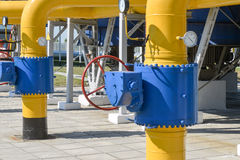 Red handle gate valve with steel pipe on gas compressor station Royalty Free Stock Photography