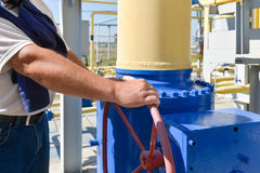 Red handle gate valve with steel pipe on gas compressor station Royalty Free Stock Photo