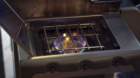 Gas cooker turn on stock video