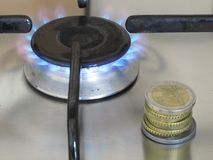 Gas cost. Propane gas burning and euro coins Stock Image