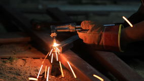 Gas cutting metal using acetylene torch