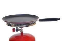 Gas cylinder. Pan on mini gas cylinder - white background stock photo