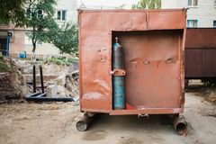 The gas cylinder is fixed for the construction van. The old gas cylinder is fixed for the construction van Stock Photos