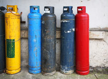 Gas cylinder. Industrial propane butane bombs. Row dirty gas cylinders. Yellow chemical bomb. Corroded welder container. Old heating bombs with valve Royalty Free Stock Images