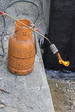 Gas cylinder with torch on flame Royalty Free Stock Photography