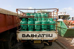 Gas cylinders being delivered to the grenadines wharf Royalty Free Stock Image