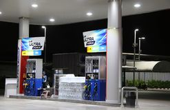 Gas dispenser of PTT gas station in Thailand on dark night. royalty free stock photography