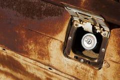 Gas Door. The rusty door to a gas tank with gas cap stock images