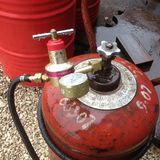 Propane gas cylinder with gauge in the rain stock image