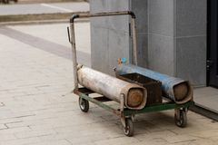 Gas cylinders for welding on a trolley near the building stock photos