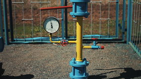 Gas factory. Processing and storage of gas and oil raw materials. Transportation of gas through a pipeline. A check. Valve with a manometer on the pipe stock footage
