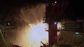 Gas fire on offshore drilling rig. Well test operations. Gas fire on offshore drilling rig. Controlled by rigs sea water firefighting system. Well test stock video