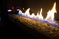Gas Fire pit with pebbles. Flames from a gas outdoor firepit filled with pebbles Stock Images