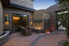 Gas Fire Pit And Sofa In Courtyard Stock Photography