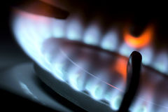 Gas fired stove. Flame from a gas stove abstractly (close-up Royalty Free Stock Images