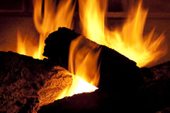 Gas Fireplace. Close up of gas fireplace and logs burning Stock Images