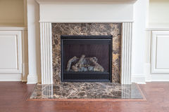 Gas Fireplace with New Hardwood Floor. A Gas Fireplace with New Hardwood Floor in new home royalty free stock images
