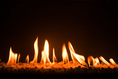 Gas fireplace with pebble crushed stones Royalty Free Stock Image