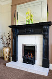 Gas fireplace and surround. Modern lounge interior with gas fire and surround Royalty Free Stock Photo