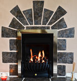 Gas fireplace and surround. Traditional gas fireplace with unusual fire surround Royalty Free Stock Photos