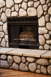 Gas Fireplace With Big Rocks On Wall Stock Images