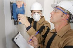 Gas fitter and supervisor. Gas fitter and his supervisor Stock Photo