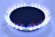 Gas flame. Blue gas flame on hob and space for text on left Stock Photography