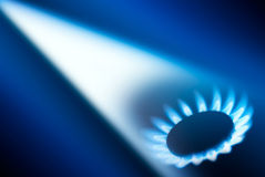 Gas flame. White ray & gas flame on blue background Royalty Free Stock Photo