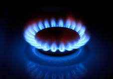 Gas flame. Kitchen oven gas flame in the dark Stock Images