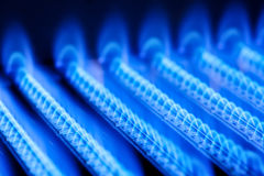 Gas flame. Blue flames of a gas burner inside of a boiler Royalty Free Stock Image