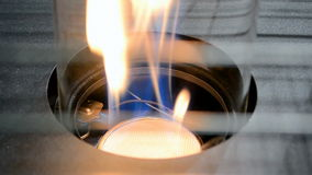 Gas flame in gas-stove, cooking closeup, stock footage