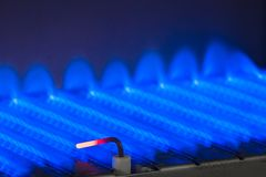 Gas flame inside of the gas boiler Stock Photo