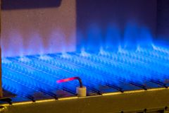 Gas flame inside of the gas boiler Royalty Free Stock Images