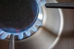 Gas flame from a stove in a kitchen. Gas flame from a stove close-up in a kitchen stock images
