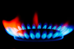 Gas flames. Blue and red flames of a gas stove in the dark royalty free stock images