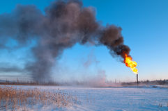 GAS FLARE. Gas flaring. Evaporation of snow Stock Image