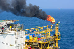 The gas flare is on the offshore oil rig. Platform Stock Image