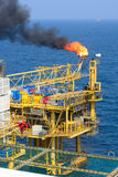 The gas flare is on the offshore oil rig Stock Photos