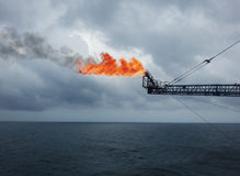 The gas flare is on the oil rig platform. royalty free stock images