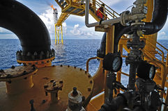 The gas flare is on the oil rig platform i Stock Image