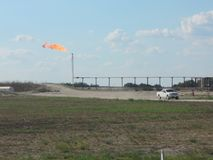 Gas Flare in West Texas. Gas flare and truck at an oil facility in West Texas Stock Images