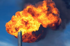Gas flaring. Burning of associated gas at oil production Stock Image