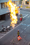 Gas flaring. Geneva, Switzerland - August 24, 2016: Technician working on emptying a city gas pipeline through gas flaring Stock Photo
