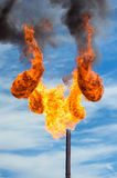 Gas flaring. Huge flame of a torch from burning of associated gas Royalty Free Stock Photos