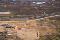 Gas flaring. At an oil field in the Russian tundra Stock Image