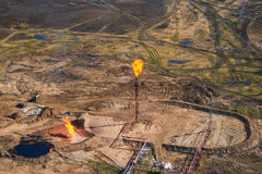Gas flaring. At an oil field in the Russian tundra Stock Photos