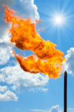 Gas flaring. Torch against the sky. Burning passing gas at oil production. Nature pollution Royalty Free Stock Image