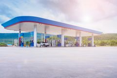Gas fuel station with clouds. In the sky and sun light royalty free stock images