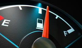 Gas Gage Illuminated Half. A closeup of a backlit illuminated gas gage with the needle indicating a half full tank on an isolated dark background Stock Photography