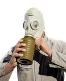 Gas Gasp. Military Man Puts On A World War 2 Gas Mask For Protection Against Poisonous Gasses Stock Photo